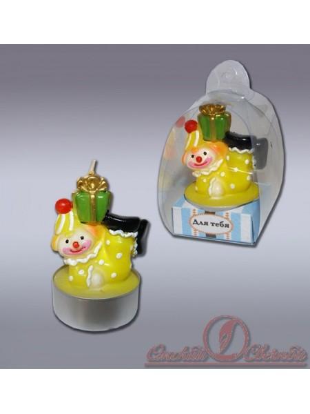 Клоун с подарком свеча